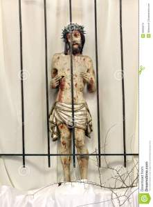 jesus-behind-bars-prison-wooden-figure-jesus-churc-church-easter-39923275