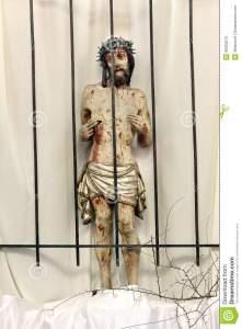 jesus-behind-bars-prison-wooden-figure-jesus-churc-church-easter-39923275